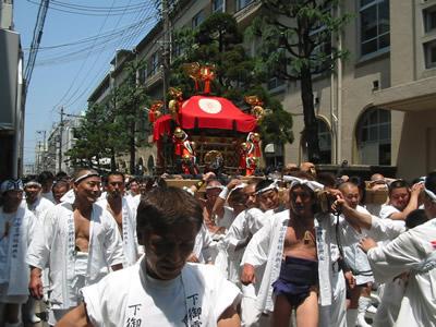 men and shrine